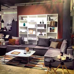 BoConcept Mezzo sofa, Lecco bookshelf & Kuta copper lamp