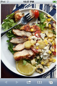Panfried chicken with and tomato and corn salad