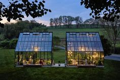 "Wonderful twin greenhouses in Pennsylvania filled with a menagerie of plants, wrought iron, sculptures, lights and cozy, over-stuffed chairs & sofas for a functional, yet amazing outdoor ""hide-away"". Photography by Roger Wade. #Home #Garden #Retreat"