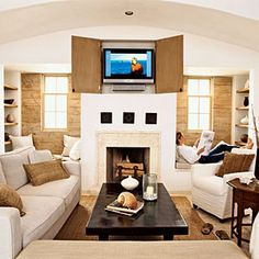 Tan and white living room. Like, but think some soft pops of color would liven it up a bit.