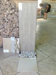 Wood tile pebble rock shower floor yes master bath for Large format glass tile