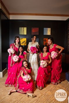 these wedding bouquets and red-pink saris <3
