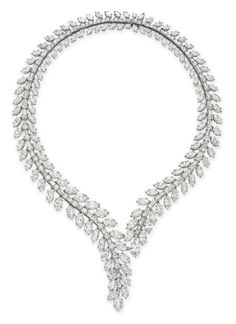DIAMOND NECKLACE, BY VAN CLEEF & ARPELS - Designed as a graduated baguette and circular-cut diamond line, extending a marquise-cut diamond fringe, to the V-shaped staggered terminals at the front, mounted in platinum, 15½ ins., in a Van Cleef & Arpels gray leather envelope case Signed V.C.A. for Van Cleef & Arpels, N.Y., no. 29361