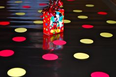 """""""Tablecloth"""" using black wrapping paper and red and yellow cardstock cut-outs."""