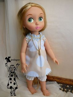 dress printed cotton polka dot doll 40 cm the outfit consists of a dress, necklace and pololo color sand with polka dots on pink or blue seal brooch