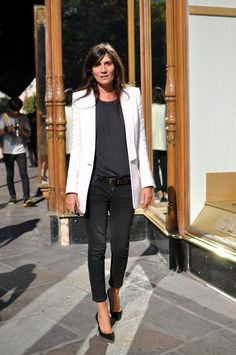 Emmanuelle Alt at Paris Fashion Week wearing a white tailored jacket with black jeans, stilettos and t-shirt.