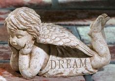 Garden Angel Statue Cherub Dream From Grasslands by Grasslands Road. $24.99. Suitable for indoor or outdoor use. See our other 5 coordinating cherubs. Kraft paper box. This cherub's message: Dream. Add a sweetness to your garden with these darling cherubs. Cement resin mix makes each cherub durable in your garden or adorable in your home. Each angel features an inspirational message that is especially nice in a serenity garden. This listing is for one angel. V...