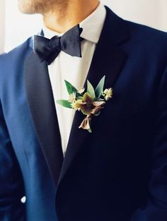 I LOVE the bow tie. It's a very sleek look. Even the flowers are nice, elegant and simple.