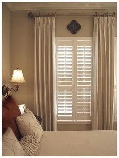 Beautiful wood  blinds complemented with neutral drapes. A functional and traditional window covering with a great look and appeal. - See more at: http://www.free-home-decorating-ideas.com/Window-Covering-Ideas.html