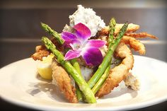 Softshell crab on a bed of risotto with a side of asparagus