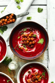 Creamy, 30-minute curried beet soup with coconut milk, curry spices, and topped with tandoori-roasted chickpeas! A hearty and healthy winter soup.