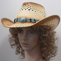35bc3693 Classic cowboy hat with toyo in natural straw coloring trimmed with a faux  turquoise band.