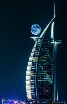 Burj Al Arab (Tower of the Arabs) is a luxury hotel located in Dubai, United Arab Emirates. At 321 m (1,053 ft), it is the fourth tallest hotel in the world. Burj Al Arab stands on an artificial island 280 m (920 ft) from Jumeirah beach and is connected to the mainland by a private curving bridge. The shape of the structure is designed to mimic the sail of a ship.