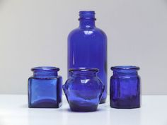 Vintage Cobalt Blue Glass Bottle Collection Medicine Ink Bottles. I repined this from http://www.ebay.com/itm/Vintage-Cobalt-Blue-Glass-Bottle-Collection-Medicine-Ink-Bottles-Set-of-4-/320931502804?pt=LH_DefaultDomain_0=item4ab9021ad4#