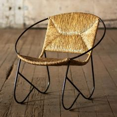 All curves and no angles make for a comfortable sitting experience. Crafted out of metal and woven rushes, this stylish chair provides a touch of the tropical modern to your décor. Its minimalist look is a quiet statement that will accentuate any space.