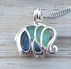 He encontrado este interesante anuncio de Etsy en https://www.etsy.com/es/listing/207509275/blue-green-mixed-sea-glass-elephant