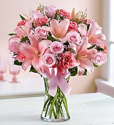 Expressions of Pink™When words aren't enough, let our thoughtful and timeless arrangement reveal the depths of your feelings. Filled with a delicate mix of roses, lilies and carnations in various shades of pink, this lovely surprise is hand-designed by our skilled florists inside a clear glass gathering vase tied with ribbon to let the beauty of each bloom shine through…and to let your most heartfelt sentiments be known.