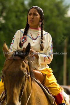 Crow woman rides in Native Days Parade at Crow Agency Montana, Crow Indian Reservation