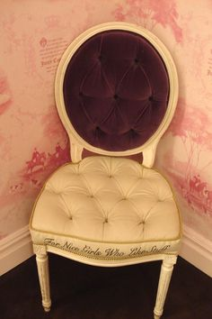 """I like the chair but the writing on the cushion """"For Nice Girls Who Like Stuff"""" is simply charming."""