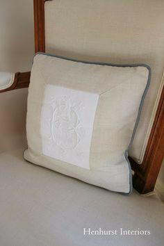 modern pillow with piece of antique embroidery originally part of a tablecloth via Henhurst Interiors