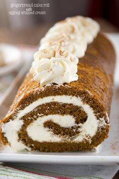 This Gingerbread Cake Roll is filled with an eggnog whipped cream! Perfect for any holiday occasion.