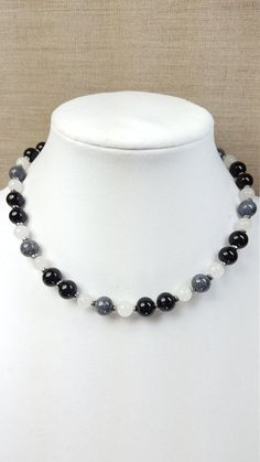 Check out this item in my Etsy shop https://www.etsy.com/listing/467740191/black-white-and-grey-natural-gemstone
