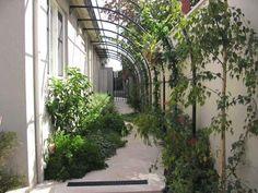 Gardens of Steel Pergolas, custom Pergolas and kit pergolas for designer gardens out of metal, steel, rusted metal, rusted steel