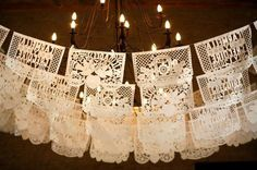 """I love paper art and nothing screams """"PAPER"""" like traditional Mexican papel picado banners and artwork. How I missed the opportunity to use these for weddings in the past 15 years is a mystery. The lovely papel picado designs Mexican Wedding Decorations, Mexican Themed Weddings, Mexican Wedding Traditions, Mexican Wedding Reception, Wedding Mexico, Hacienda Wedding, Vintage Decorations, Spanish Wedding, French Wedding"""
