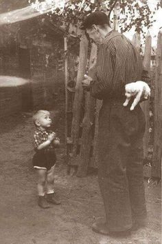 Little boy about to receive a puppy (1955)