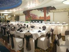 Ballroom One at Arnaldo's Banquet Center ~ Wedding Reception Venuehttp://www.arnaldosbanquetcenter.com/ The mural behind the head table has been replaced with a wave wall and a programable colored lighting option.