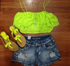 Love this outfit. I love crop tops and there so in right now. I love the ruffles on this one and the bright green is perfect for summer. I also love how its paired with a long necklace. The shoes are also really cute and match the outfit perfectly.