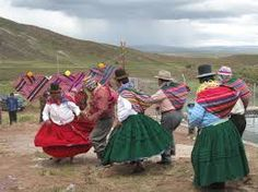Even while dancing, the aguayo is a constant companion on the Altiplano.