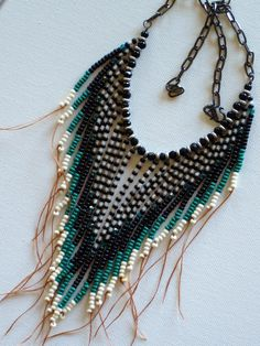 Native American tribal style fringed beaded necklace in teal, black and cream