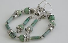 http://www.adhicreations.com/products/246-jade-bracele  Jade Bracelet& Earrings Set  Gorgeous Bracelet made of a variety of green jade beads. Along with the silver finish pewter beads, this is truly one of a kind. Add the Matching Necklace from the related product section and make it a lovely three piece jewelry set. The Bracelet & Earrings set is packed in an Exclusive, Signature style Jewelry box that highlights the jewelry's richness.  Product ID : BE1021  Availability: In stock  $20.00…