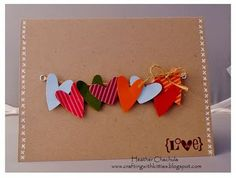 """Crafting with Kitties: Punched Hearts Card"" - Cute way of using eyelets."