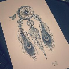 dream catcher with peacock feathers and humming bird