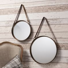 A pair of stylish round metal framed mirrors with bronze finish and faux leather hanging straps. Hanging These mirrors are fitted with a faux leather hanging strap. Mirror Overall Diameter: or or Round Hanging Mirror, Round Mirrors, Framed Mirrors, Mirrors Quirky, Decorative Mirrors, Circular Mirror, Full Length Mirror Wall, Mirror Set, Sun Mirror