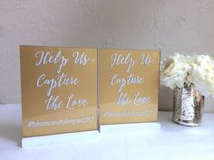 Pair of custom acrylic instagram signs with gold back paint (*upgrade for back paint is no longer offered) and geometric wood stands. Hand painted plexiglass wedding signage.