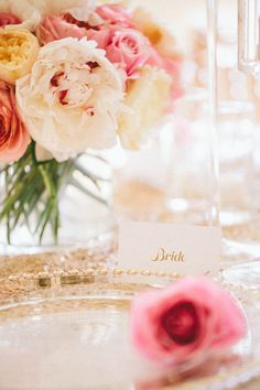 Kauai, Hawaii Wedding table setting. Pink and gold wedding decor and flowers. Bride place card. Modern Pacific Weddings. Photo by Rebecca Arthurs