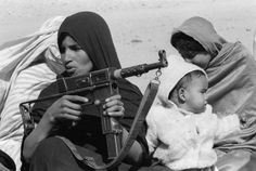 """Polisario Front Female Soldiers holding """"Makeshift"""" weapon date unknown - uniform"""
