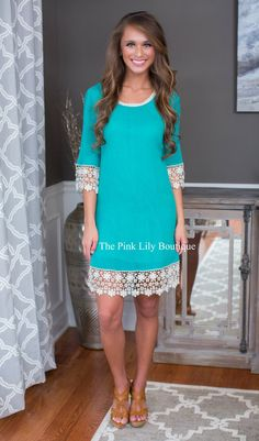 This beautiful dress is trimmed in bands of contrasting lace, adorning the sleeves and hemline!