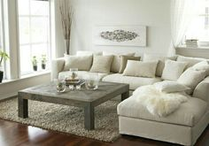 Slipcovered sectional & collection of pillows