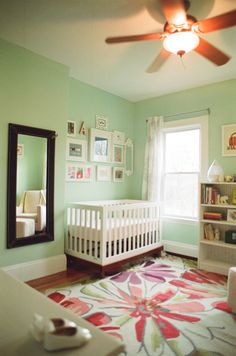 Boston Nursery: A colorful and peaceful space with the most gorgeous mint walls, floral rug, and BabyMod Olivia Crib
