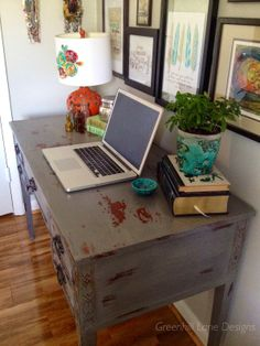 A chippy, distressed desk painted in Miss Mustard Seed's Trophy Milk Paint.
