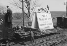 News Photo: Men checking on the protective structure around ... Pyrex, Corning Glass, New York, Train Rides, Pop Culture, News, Image, Pictures, New York City