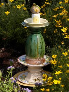Fancy #4 - Rich green tones draw the eye to this garden fancy. Cold-hardy 'Moonbeam' coreopsis and the 22-1/2-inch-tall garden art made with plates, a candlestick, a vase, a tea-light candleholder, and a little bird create a classy coupling.