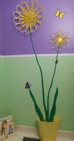 This one started with a piece of metal wall art I hung on the wall after a powder room makeover. The large yellow flower was kind of lost all by itself. First, I added the stem & 2 leaves. Then, I added the smaller flower. Next, came the butterflies & ladybug. I had already placed the yellow trash can in the bathroom and got the idea to turn it into a flower pot.