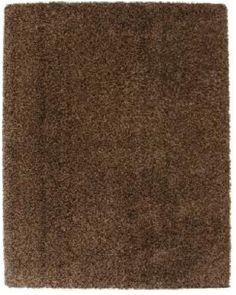 Don't underestimate the statement that a solid-colored area rug can make, especially when it's cushiony shag underfoot.