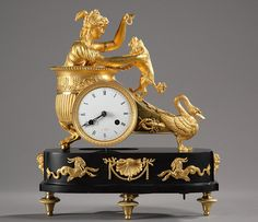 Empire period mantle clock representing a woman draped in antique dress, in a chariot pulled by a swan, playing with a dog. Lobster patterns adorn the sides of the chariot...
