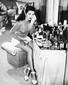 Ann Miller at her dressing table...